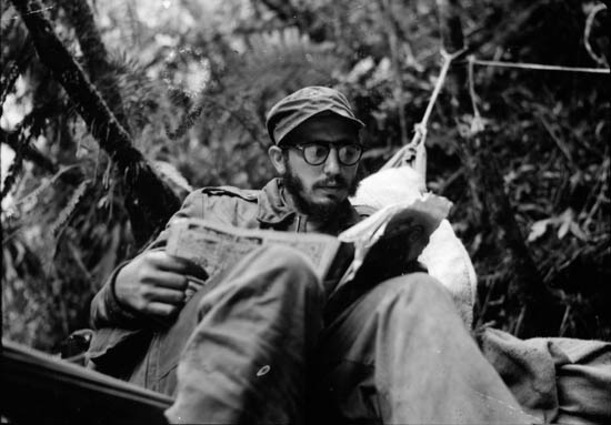 Sierra Maestra Mountains, Eastern Cuba - Fidel Castro catches up on the news at an outpost in the Sierra Maestra. Castro commanded his guerilla forces from this rugged mountainous region from December 1956 to November 1958. (photo credit: Yale University/Andrew St. George)